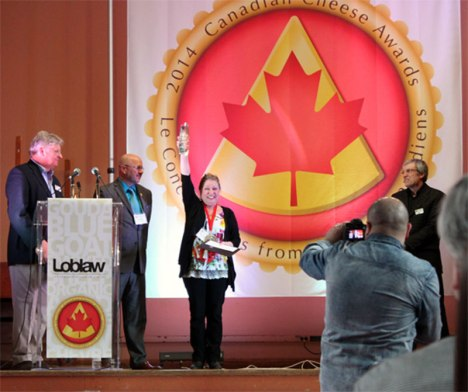 Marie-Claude Harvey, Fromagerie FX Pichet, flanked by Georgs Kolesnikovs, chairman, Canadian Cheese Awards, Gurth Pretty, Loblaw Companies, Marquee Sponsor, and Dr. Arthur Hill, Chief Judge, Canadian Cheese Awards.