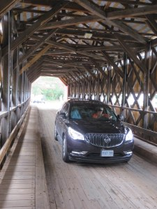 Our Buick Enclave is shown crossing a covered bridge near the end of our Gaspé #buickdrive.