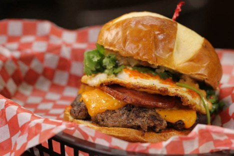 Beef from Enright Cattle transformed into a gourmet cheeseburger by Burger Revolution.