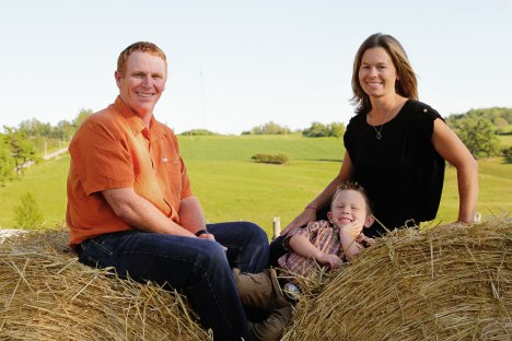 Darold and Kara Enright with young Corben on the their beef farm near Tweed, Ontario. Now, there is second young one, Evelyn.